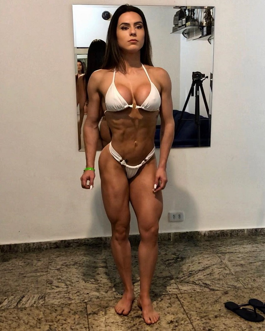 Karen Ranocchia Brandao posing for the photo in a white bikinig looking ripped and toned
