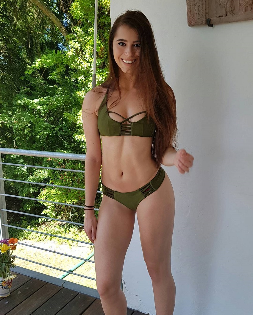 Mirjam Cherie posing for a photo in a bikini looking fit and lean
