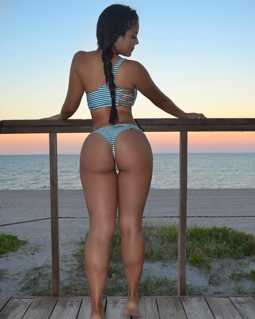 Nicole Borda posing by the porch looking curvy and fit