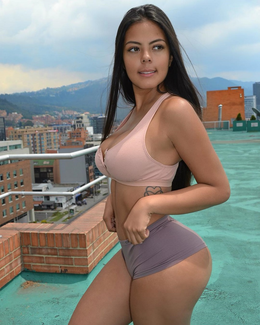 Nicole Borda posing by an exotic pool on a building rooftop