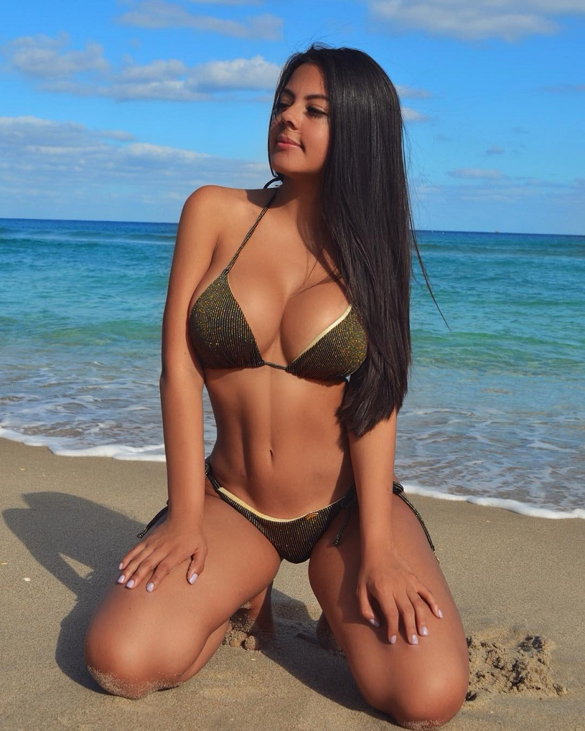 Nicole Borda posing on the beach looking fit and lean