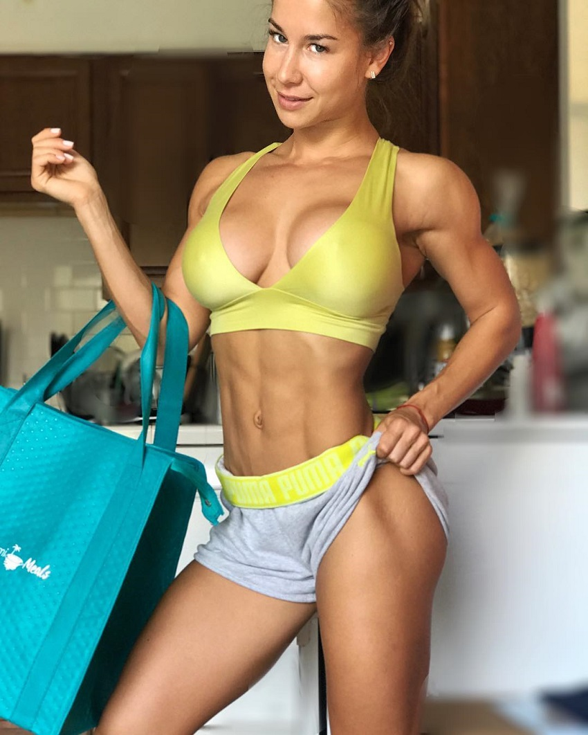 Nika Lazutina showing off her lean and busty physique for the photo