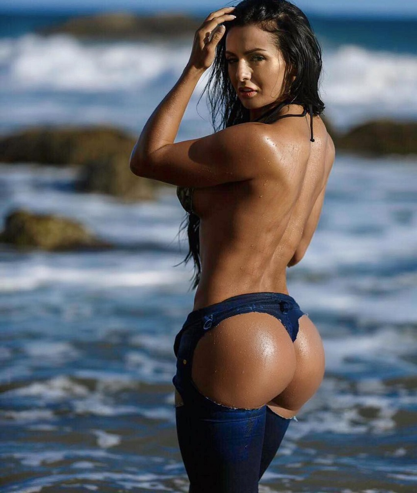 Paola Macias posing by the sea showing off her curvy glutes