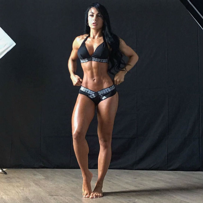 Paola Macias posing for teh camera looking lean in her swim suit