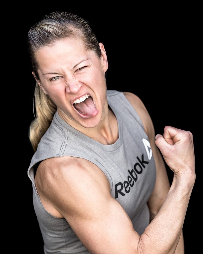 Rebecca Voigt Miller flexing her biceps for the camera looking strong