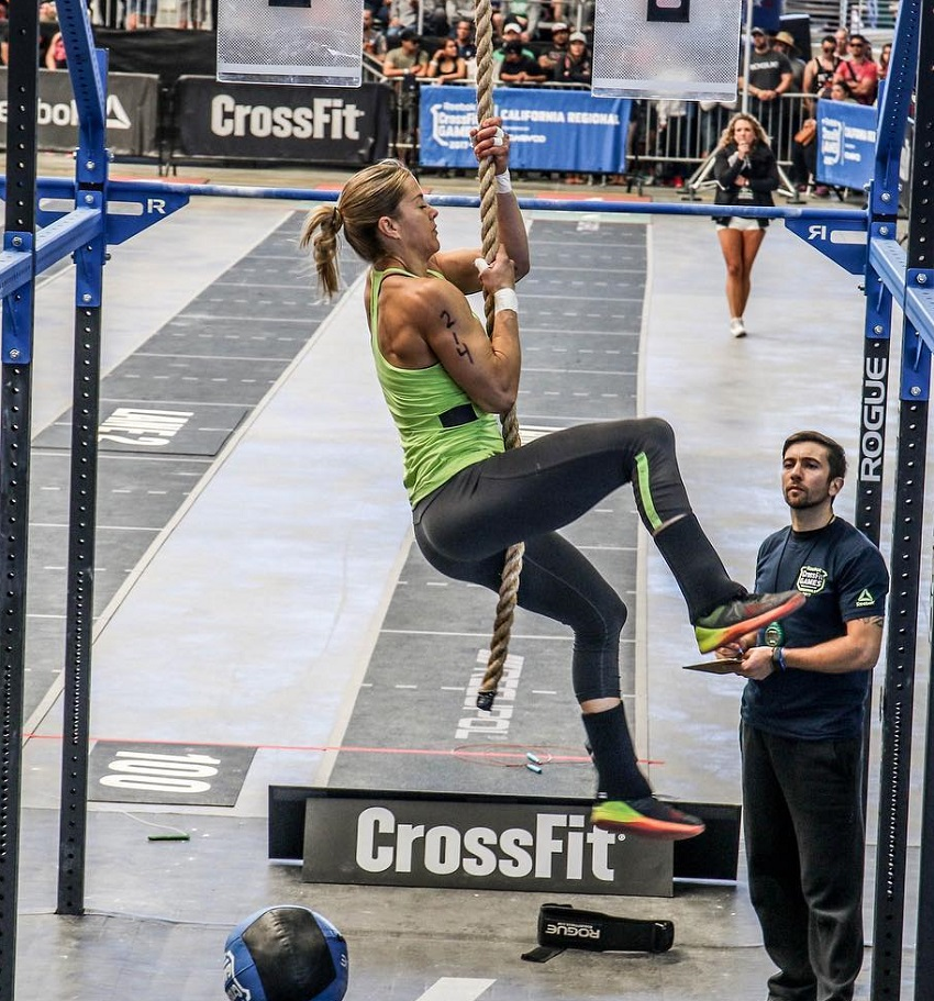 Rebecca Voigt Miller climbing rope during a CrossFit competition