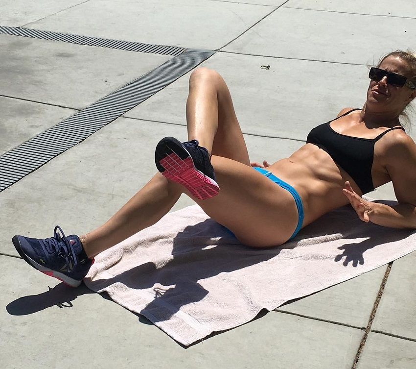 Rebecca Voigt Miller doing twisted crunches looking lean and fit