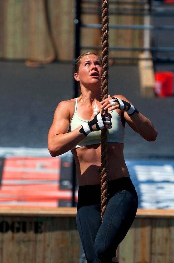 Rebecca Voigt Miller climbing rope during a CrossFit event