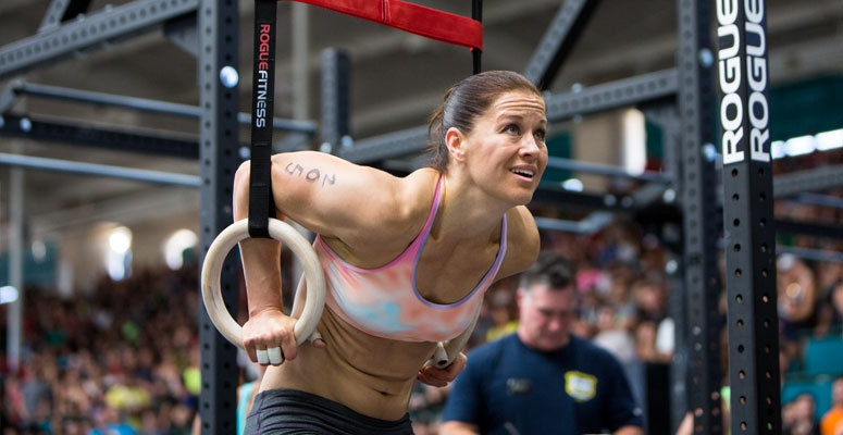 Rebecca Voigt Miller doing ring exercises during a CrossFit event