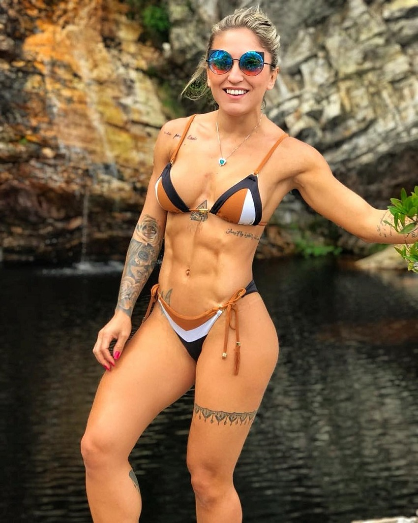 Roberta Mezencio posing for a photo in an exotic location looking fit and lean