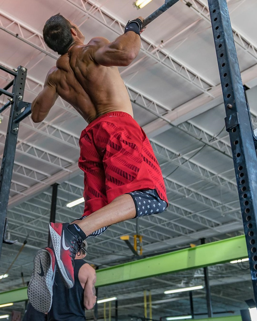 Shawn Ramirez doing pull ups while shirtless