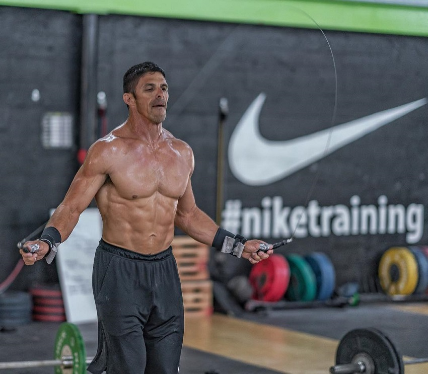 Shawn Ramirez skipping ropes shirtless during a CrossFit workout.