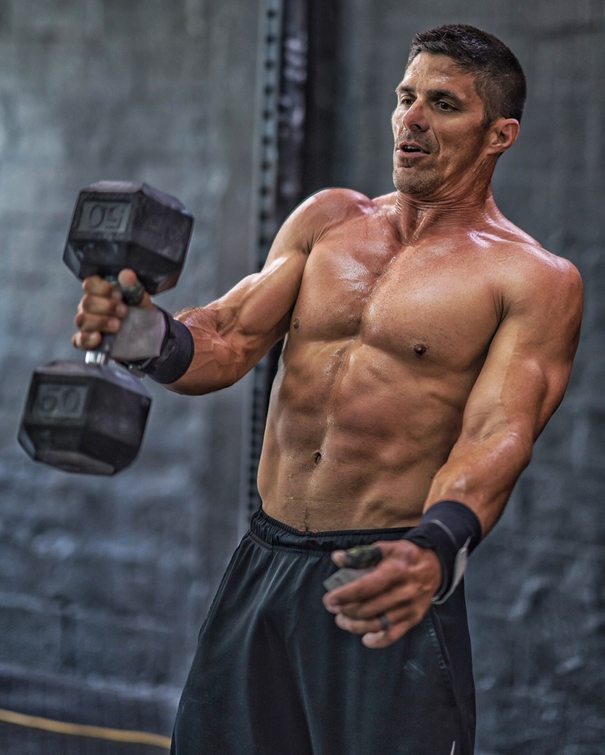 Shawn Ramirez lifting a dumbbell looking ripped and strong.