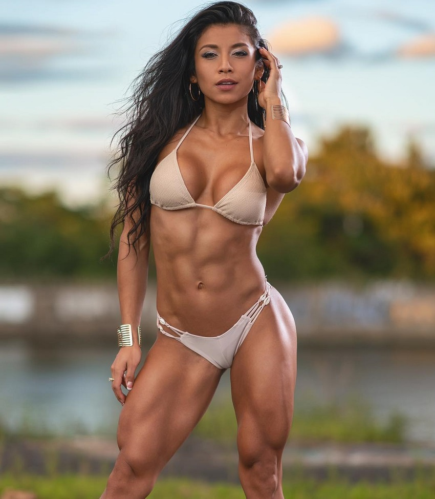Stephanie Ayala posing in her bikini for a modeling photo shoot looking ripped and aesthetic