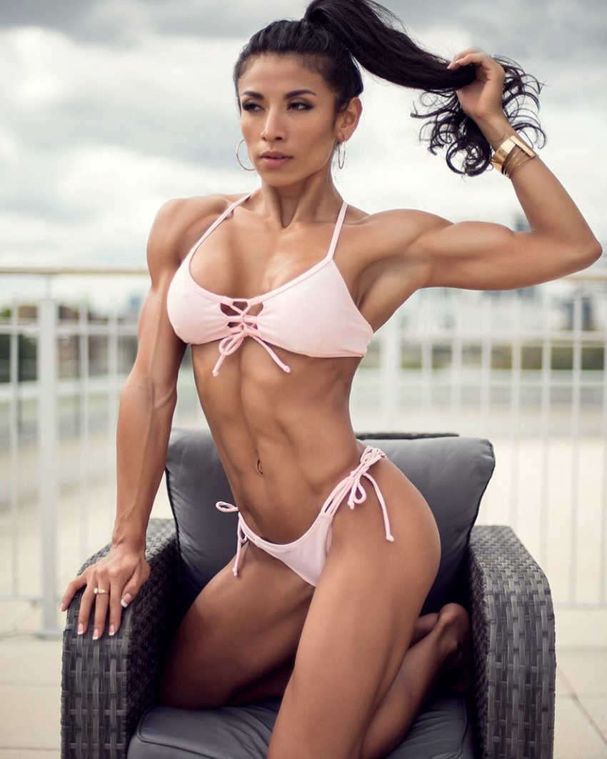 Stephanie Ayala posing for a photo shoot looking ripped and toned