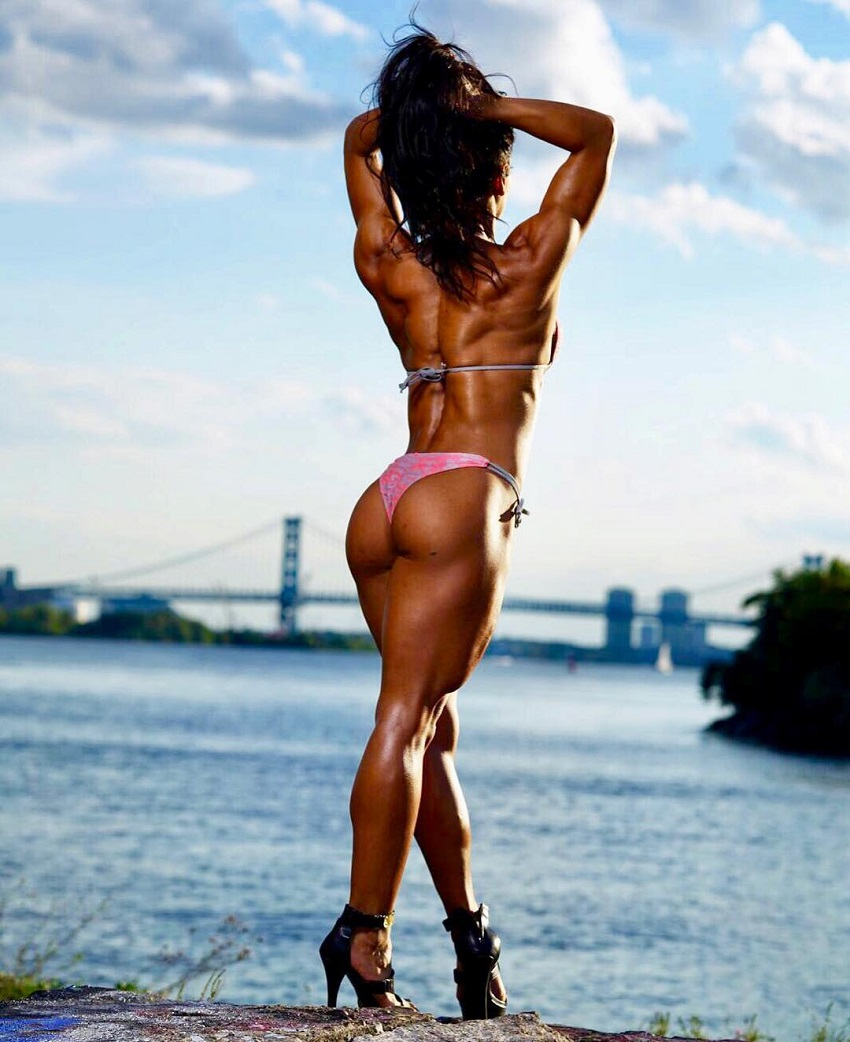 Stephanie Ayala posing in a bikini showing off her back and glutes