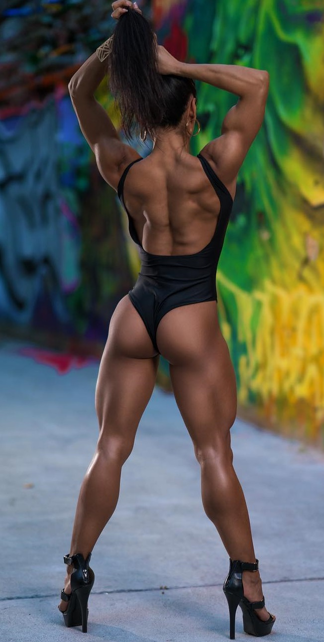 Stephanie Ayala posing with her back and glute muscles showing off