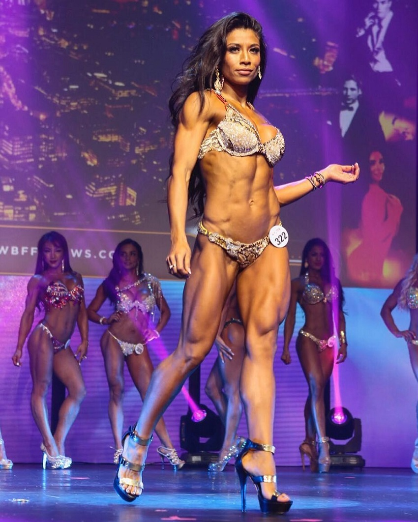 Stephanie Ayala standing on the WBFF stage looking ripped and toned