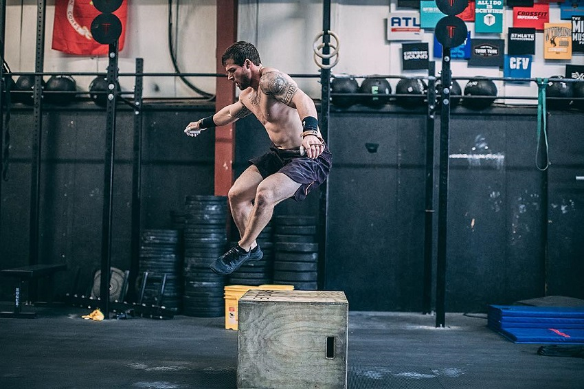 Travis Mayer working out in a CrossFit gym