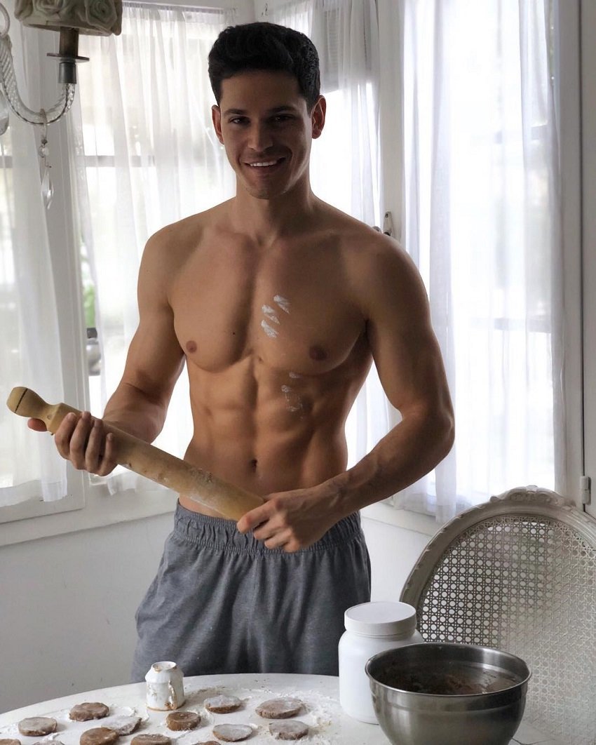 Andrea Moscon posing shirtless in the kitchen