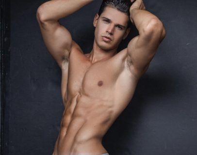 Andrea Moscon posing shirtless in a modeling photo shoot looking ripped