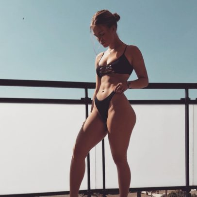 Celie Josefine Lindblad posing on the balcony looking curvy and fit