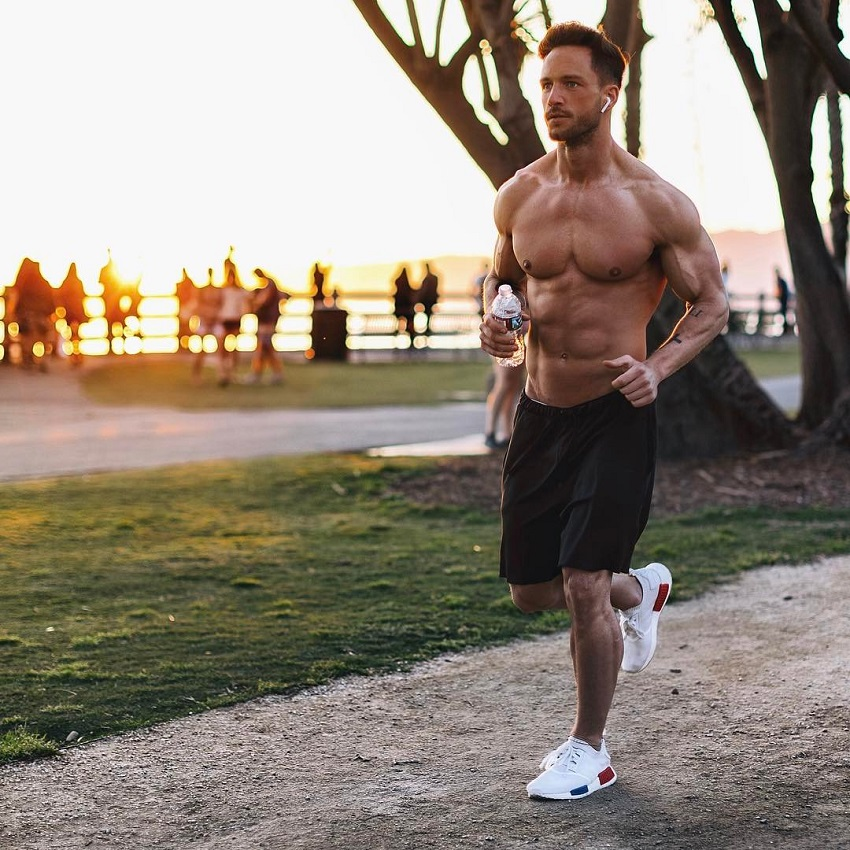Daniel Fox running shirtless outdoors