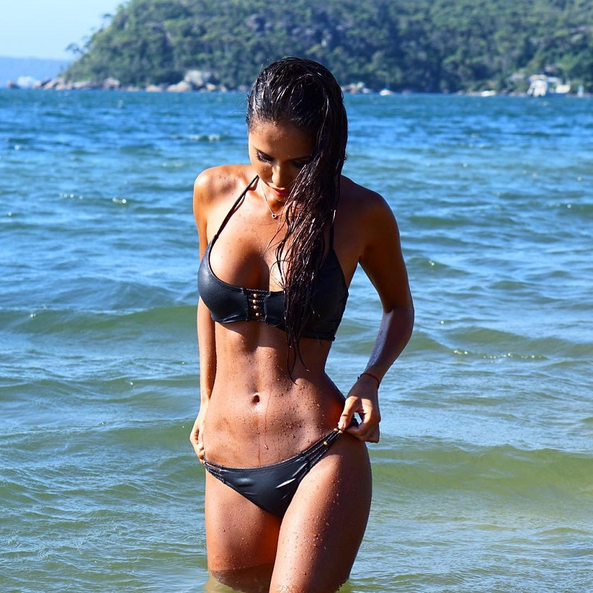 Dilya Diaz standing in the sea looking fit and aesthetic