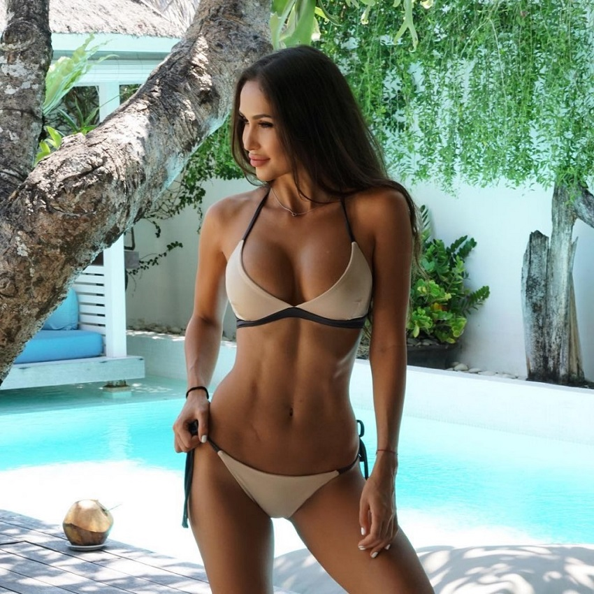 Dilya Diaz posing for a photo in a bikini looking fit and lean