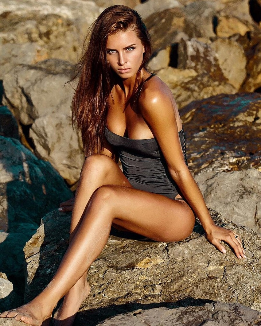 Josefine Forsberg sitting on a rock looking fit and toned