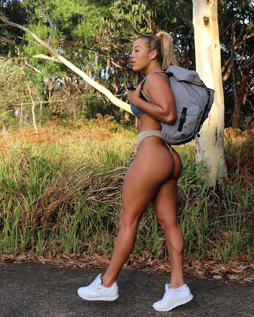 Kali Burns hiking with a backpack, displaying her curvy legs and glutes