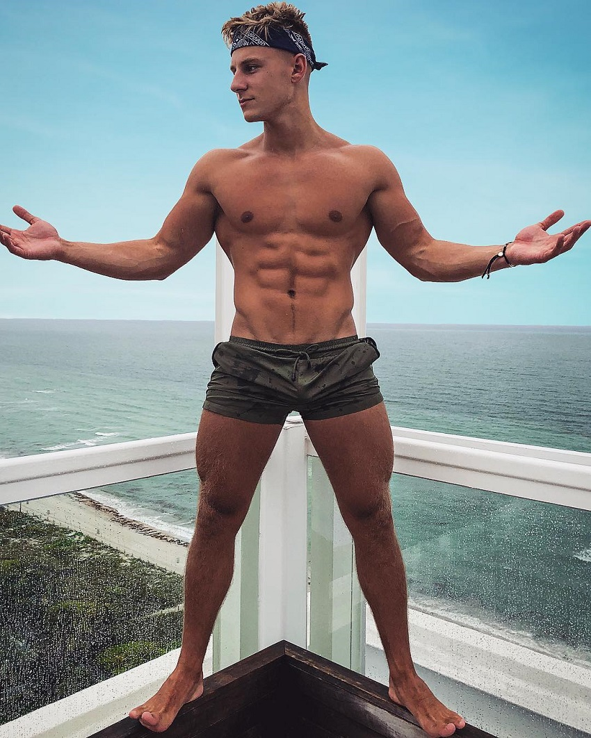 Max Wyatt posing on a balcony looking fit and lean