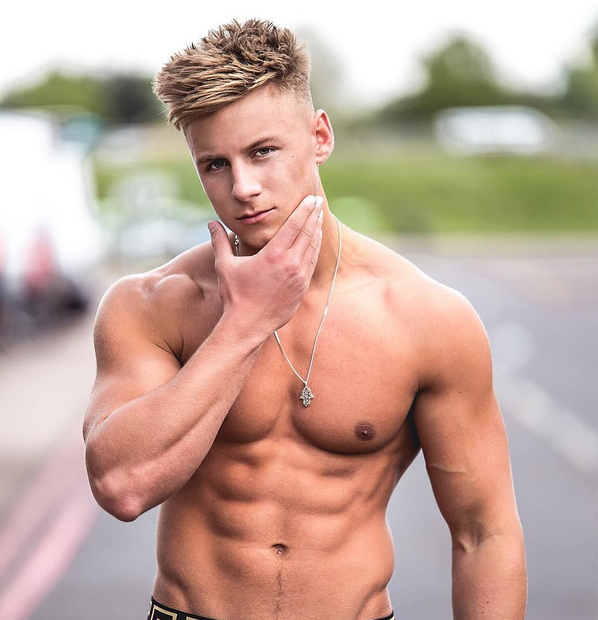 Max Wyatt posing shirtless for a photo looking strong and fit