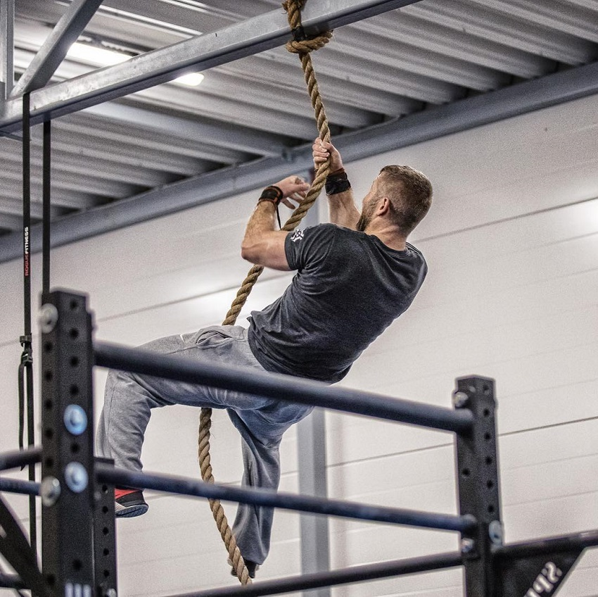 Mikko Salo climbing a rope looking fit and strong