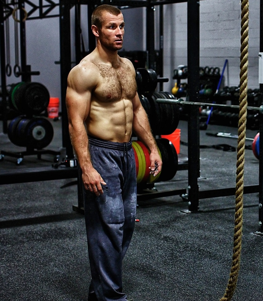 Mikko Salo posing shirtless for a photo looking ripped and strong