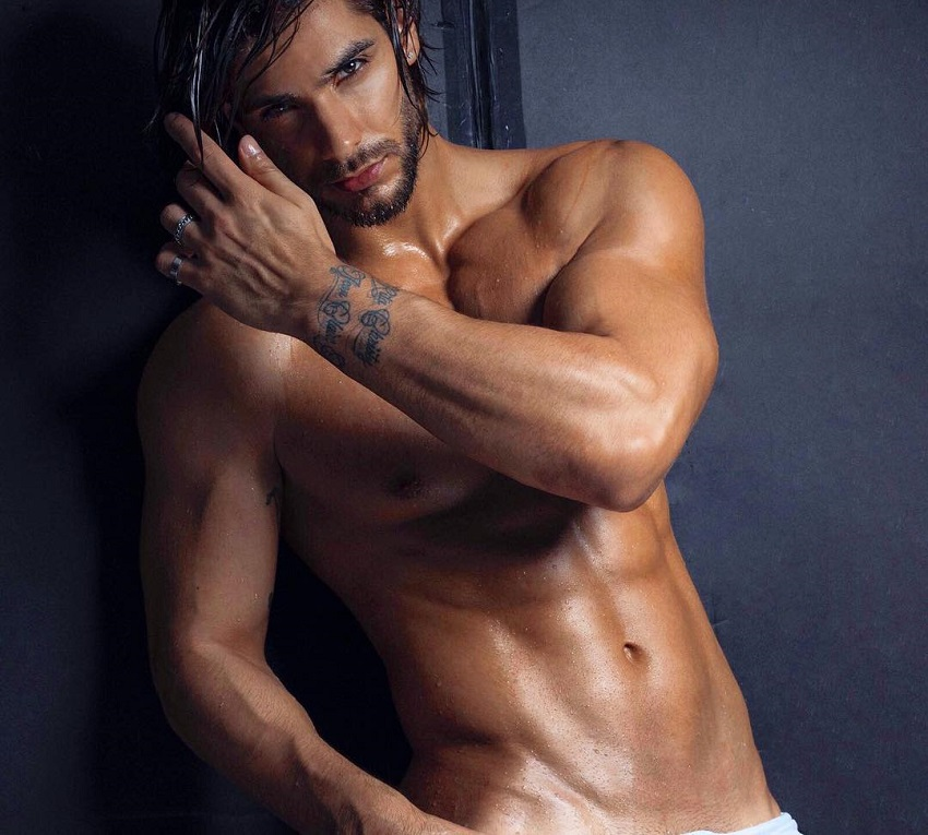 Paul Iskandar posing in a modeling photo shoot, looking chiseled