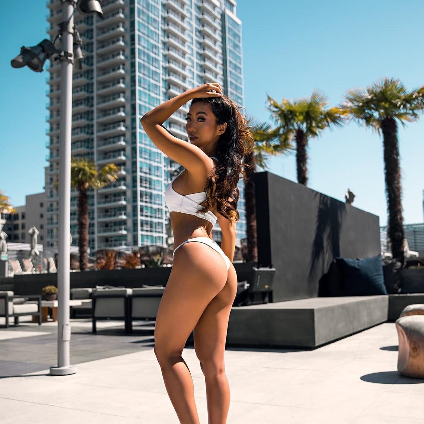Victoria Nguyen showing off her curvy legs and glutes in the middle of a city
