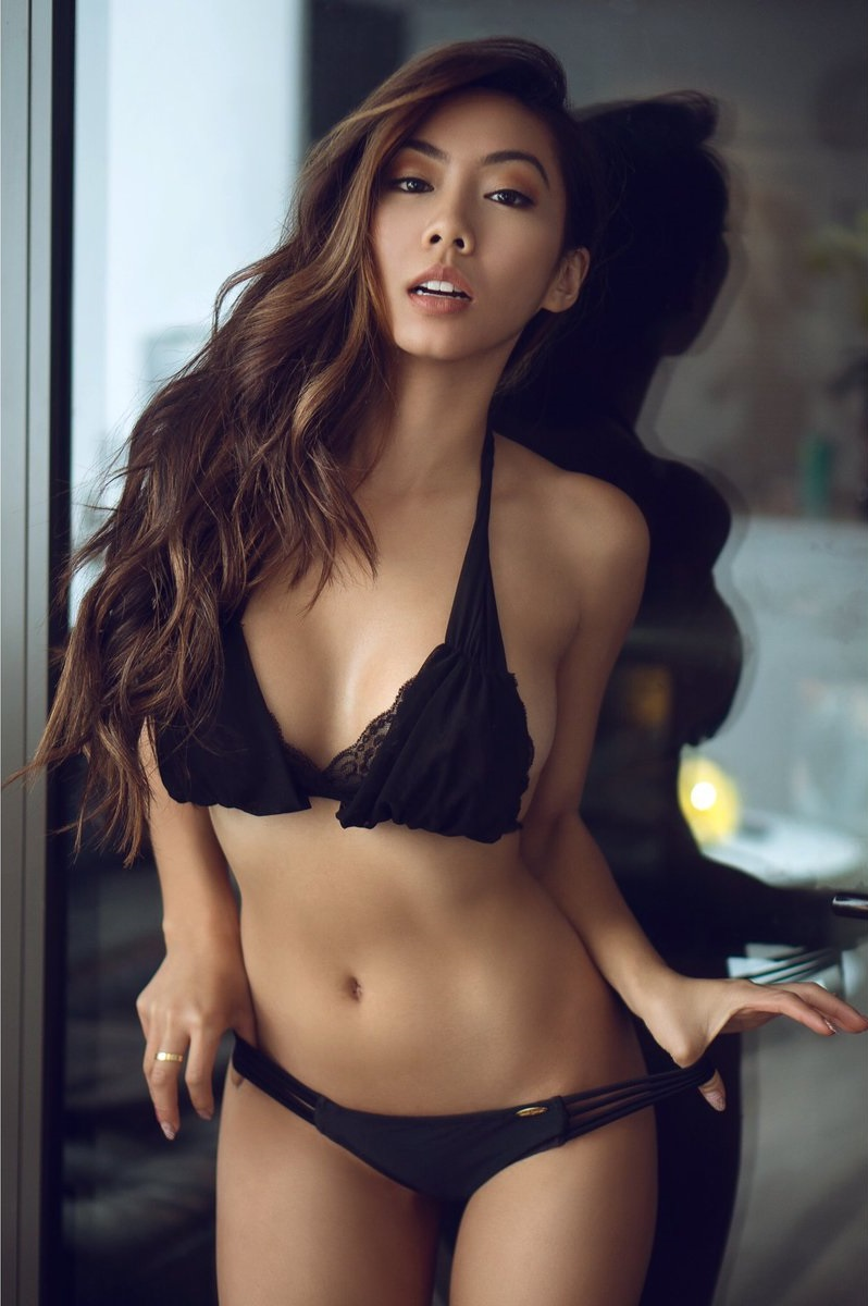 Victoria Nguyen posing for a photo in black bra and panties looking fit and lean
