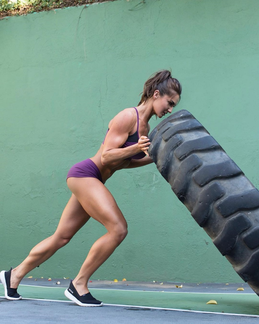 Whitney Johns flipping a big and heavy tire, looking strong and lean