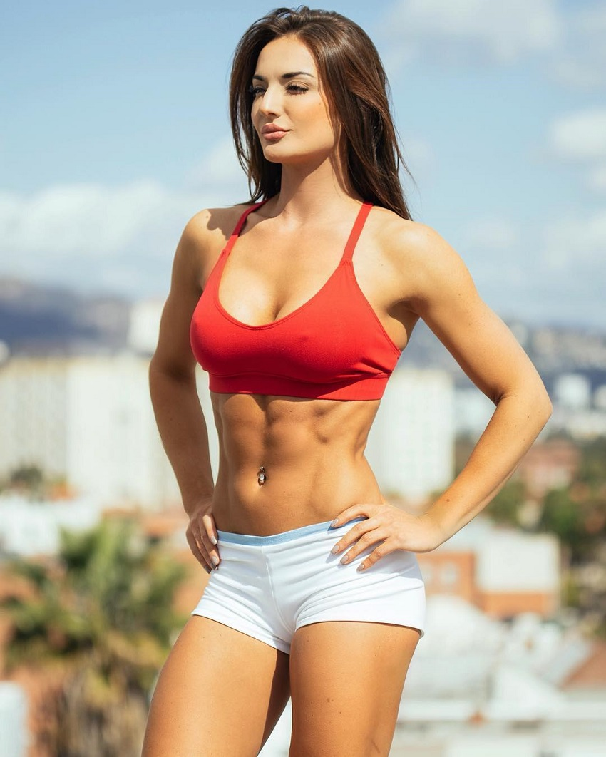 Whitney Johns posing in a professional photo shoot looking lean and toned