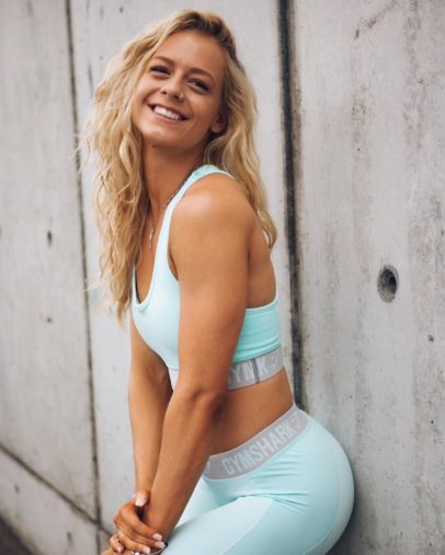 Becca Louise Sills smiling for a photo looking fit and toned