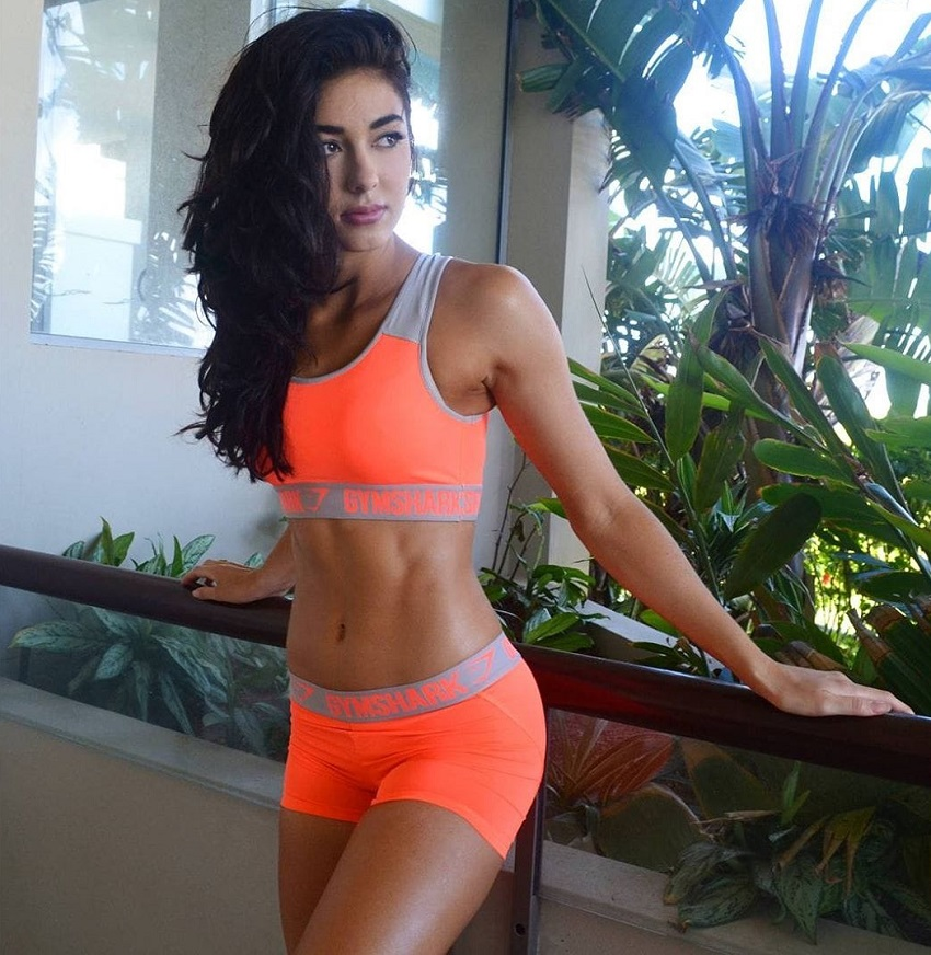 Danielle Robertson posing for a photo in sportswear
