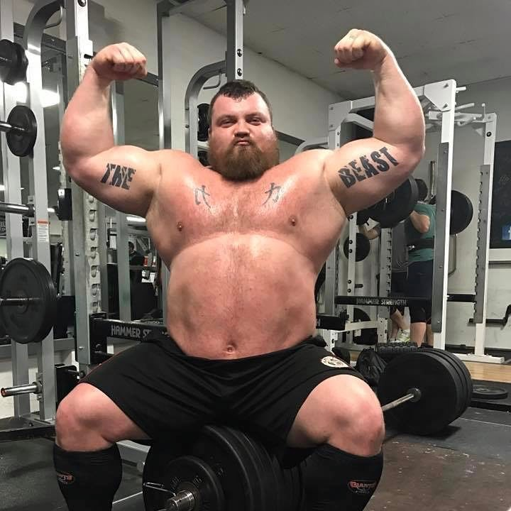 Eddie Hall performing a shirtless front double biceps pose for the photo