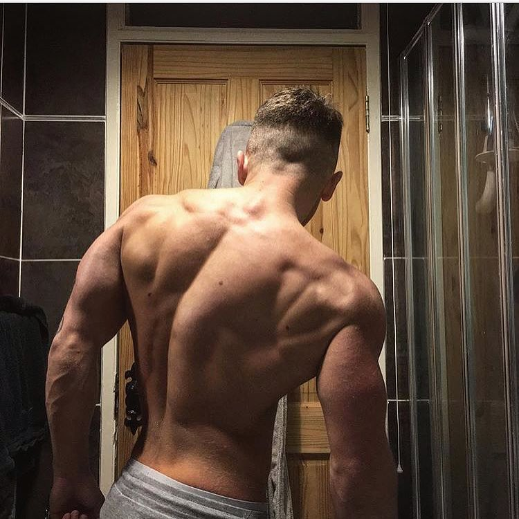 Glen Gillen showing off his shirtless back muscles
