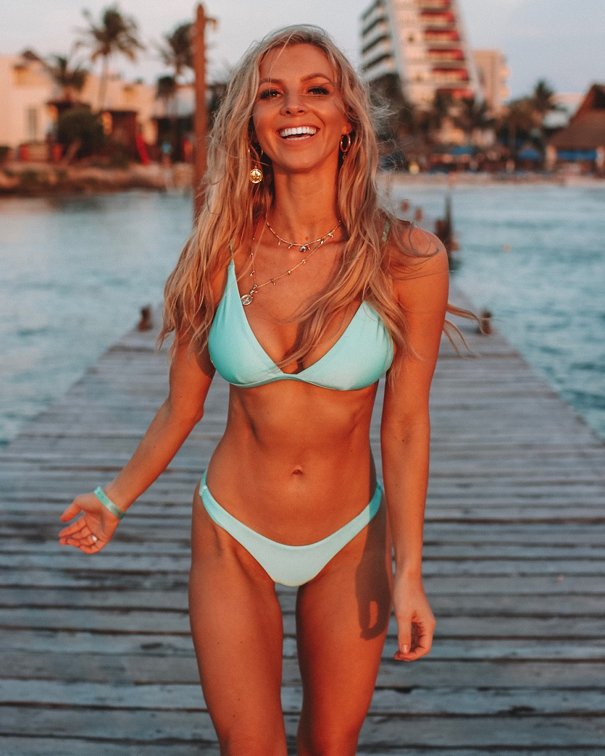 Hannah Polites smiling for a photo wearing a light blue bikini