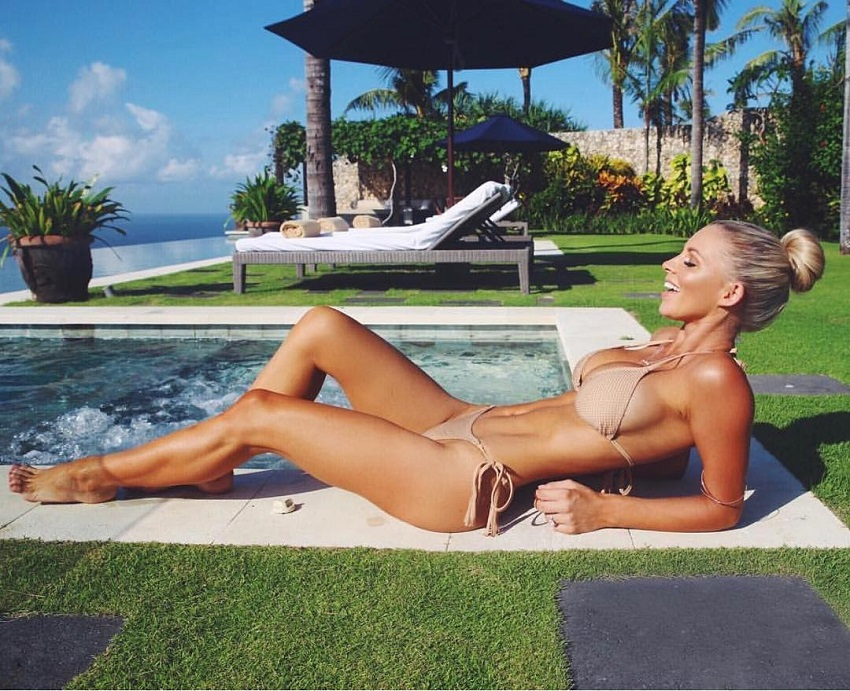 Hannah Polites lying close to a jacuzzi soaking up the sun