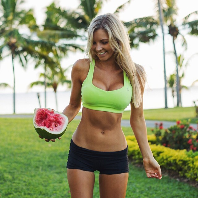Hannah Polites posing for a photo with a watermelon in her hand