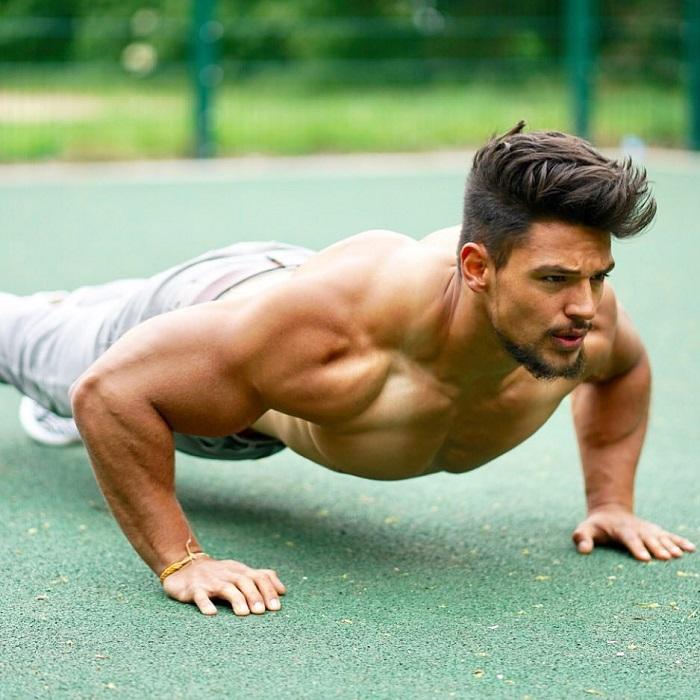Jamar Pusch doing push-ups shirtless