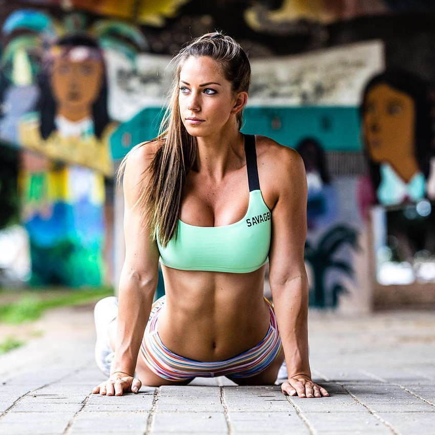 Janna Breslin performing yoga looking fit and lean