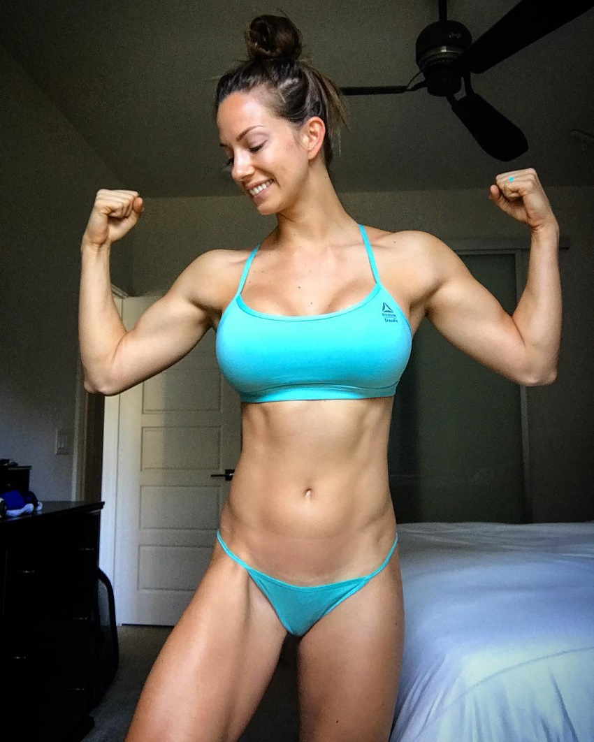 Janna Breslin flexing her muscles for the photo looking ripped and curvy